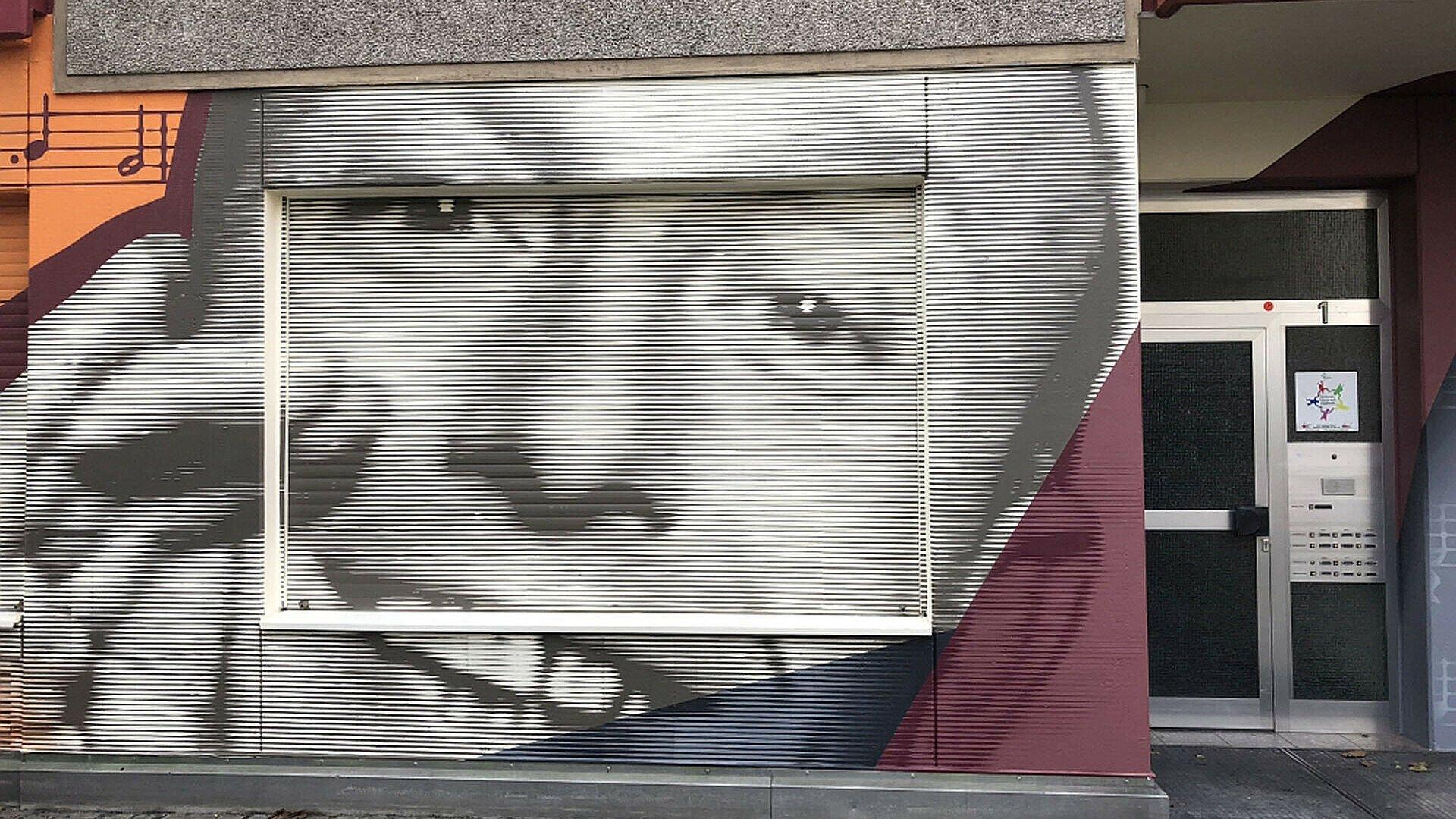 Mit Rastertechnik gestaltetes Fassadenteil in der Südstadt